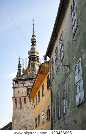 Low Angle View Of The Clock Tower At Sighisoara In Romania, Saxon Landmark