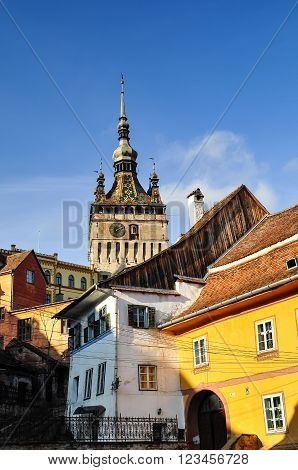 Medieval City Of Sighisoara With Clock Tower, In A Warm Summer Morning, Romania
