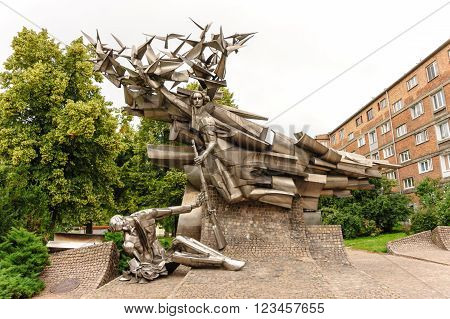 GDANSK POLAND - JULY 6 2009: Defenders of the Polish Post Office monument designed by Wincenty Kucma represents a dying Polish post employee being handed a rifle by Nike a little too late