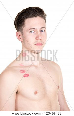 young handsome man with kiss imprints on cheek and neck
