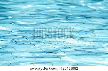 Background of rippled water in swimming pool / Blue ripped water in swimming pool (swimming, pool, wave)