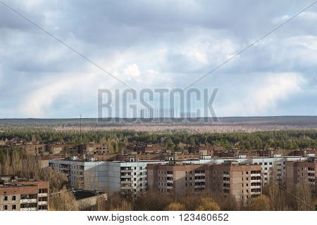 Buildings in the abandoned city of Pripyat and soviet milytary antenna DUGA at the horizon. Panoramic view