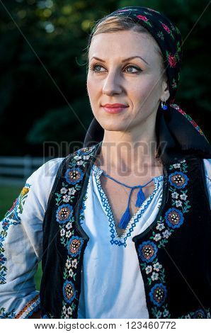 Close Up Of Young Beautiful Singer Posing In Traditional Costume, Romanian Folklore