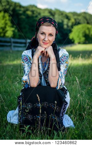 Portrait Of Young Beautiful Woman Posing In Romanian Traditional Costume