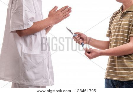 Close up of man, holding a knife in his hands, threatening a doctor and asking for money, representing the concept of danger