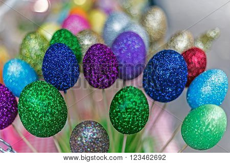 Background with eggs forms decorated ornamental for Easter and supported by a stick.
