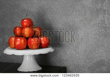 Ripe juicy apples on white plastic tray