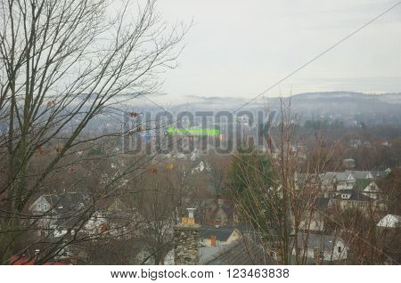 The city of Torrington Connecticut in the hills of the northwest corner during early spring on a rainy misty morning.