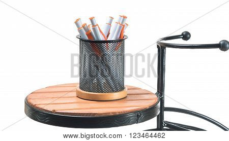 Set Of Ballpoint Pens In Glass On Wooden Table