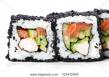 Japanese sushi rolls with salmon shrimp and cucumber in black tobiko roe closeup