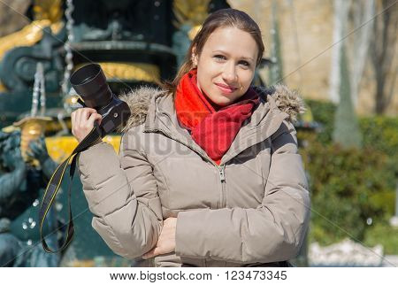 woman photographer with camera, in red scarf