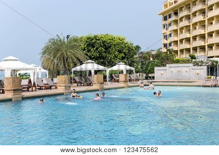 THAILAND, PATTAYA, MARCH, 26, 2015 - Tourists bathing in the swimming-pool at hotel Dusit Thani, Pattaya,  gulf of Siam, Thailand.
