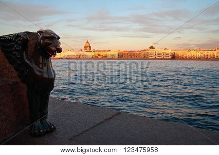 Griffon's head Neva River and St. Petersburg skyline Russia