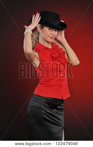 Fashion girl in black hat. Young  lady in red