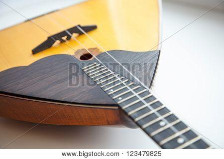 The balalaika Russian folk musical instrument yellow ** Note: Shallow depth of field