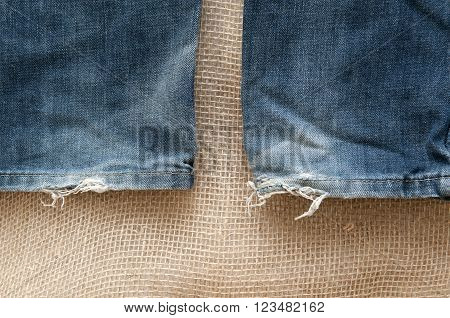 Photo of old denim clothes on the background fabric