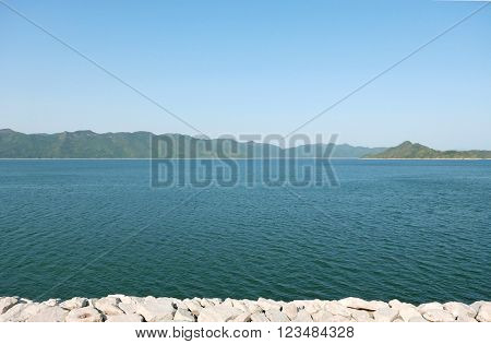 Dam Pond, Mountains And Blue Sky