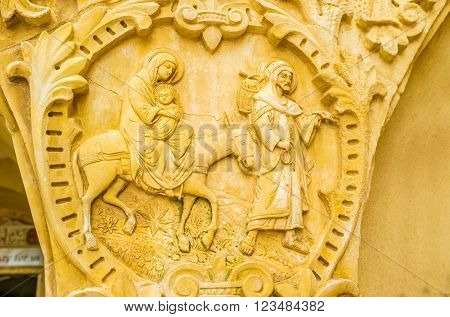 BETHLEHEM PALESTINE - FEBRUARY 18 2016: The beautiful stone medallion with the Holy Family located on the capital of the column of Milk Grotto on February 18 in Bethlehem.