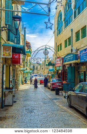 BETHLEHEM PALESTINE - FEBRUARY 18 2016: The Pope Paul IV street is the central trading street with a lot of shops and cafes on it on February 18 in Bethlehem.