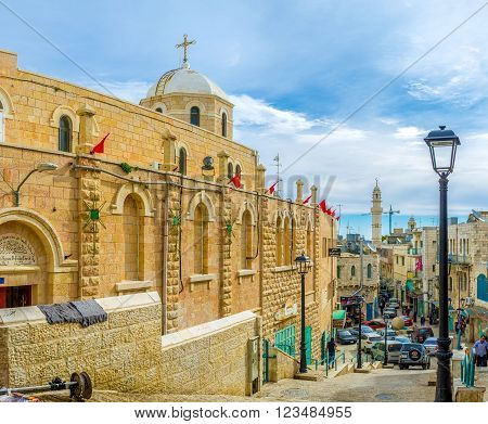 BETHLEHEM, PALESTINE - FEBRUARY 18, 2016: The main street of the pilgrimage city with a lot of religion sites such as St. Mary Syrian Orthodox Church on February 18 in Bethlehem.