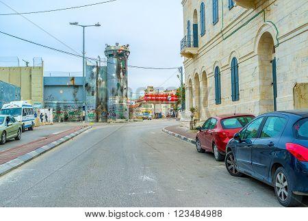 BETHLEHEM, PALESTINE - FEBRUARY 18, 2016: The damaged tower of separation wall in Bethlehem on February 18 in Bethlehem.