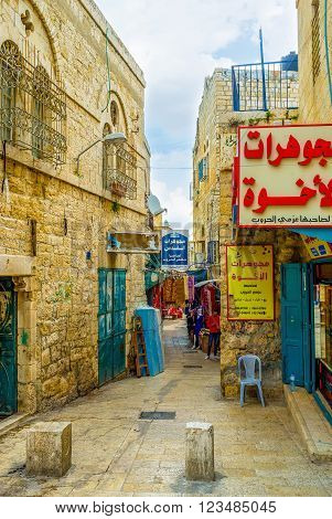 BETHLEHEM, PALESTINE - FEBRUARY 18, 2016: The narrow street in old part of the city with a lot of souvenir shops on February 18 in Bethlehem.
