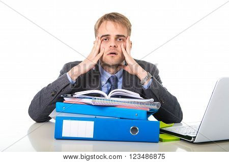 overwhelmed and worried businessman suffering stress sitting at office computer desk looking desperate and frustrated
