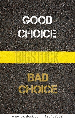 Antonym decision concept of BAD CHOICE versus GOOD CHOICE written over tarmac, road marking yellow paint separating line between words
