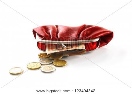 Purse with euros and coins isolated on white