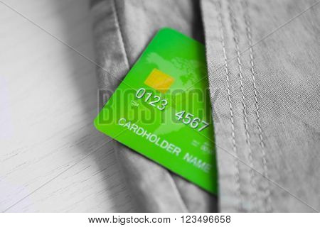 Credit card in trouser pocket, close up