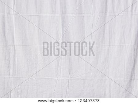 Closeup of a white cotton sheet drying in the sun