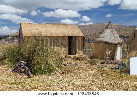 Huts At Uros Floating Island And Village On Lake Titicaca Near Puno,  Peru