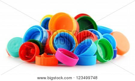 Composition with colorful plastic bottle caps on white