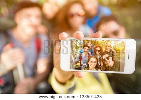 Close up of mobile phone making selfie