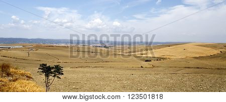 View of the fields on the outskirts of Cordoba Spain on a hot summer day