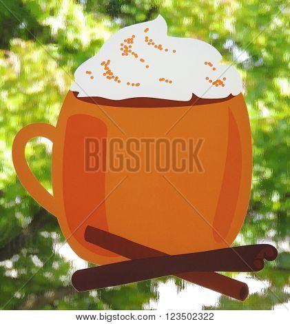 Orange mug decal with blurry green trees out the window