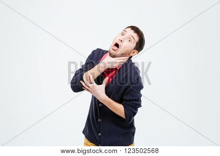 Man strangling herself isolated on a white background