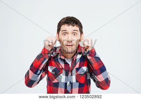 Man making a silly monkey face isolated on a white background