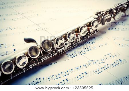 Flute on musical notes background