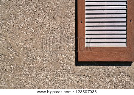 Simple horizontal shutter on exterior stucco wall