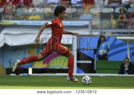 BELO HORIZONTE BRAZIL - June 17 2014: Axel WITSEL of Belgium compete for the ball during the World Cup Group H game between Belgium and Algeria at Mineirao Stadium.