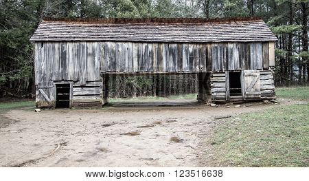 Pioneer Barn Background. 18th century pioneer barn in the Cades Cove area of the Great Smoky Mountains National Park. This is a public display in a national park and not private property.