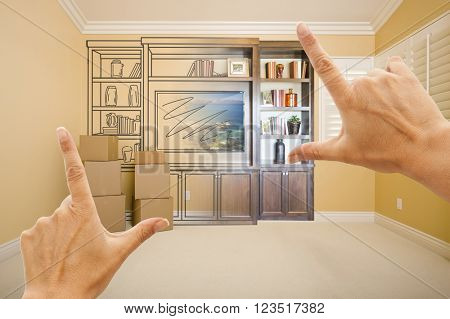 Hands Framing Drawing of Entertainment Unit Gradating Into Photograph In Room With Moving Boxes.