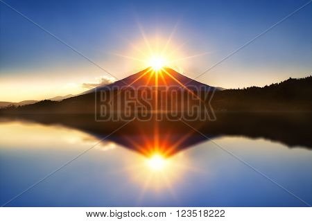 Mount fuji with diamond by lens flare on the top at Lake kawaguchiko,Sunrise