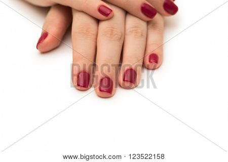 Woman hands with red nail isolated on white