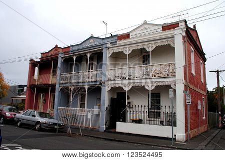MELBOURNE, AUSTRALIA, MAY 21: Row of colorful two-storey terraced houses in Melbourne, Victoria, on May 21, 2015.