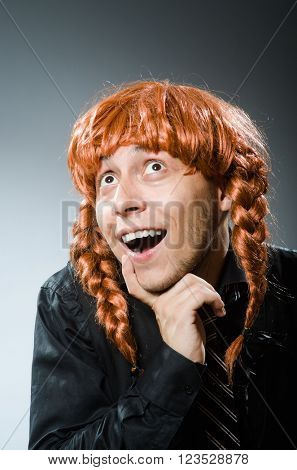 Funny man with red hair wig