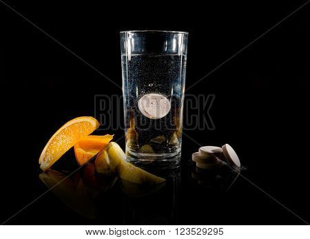 Effervescent tablets and glass of water and orange