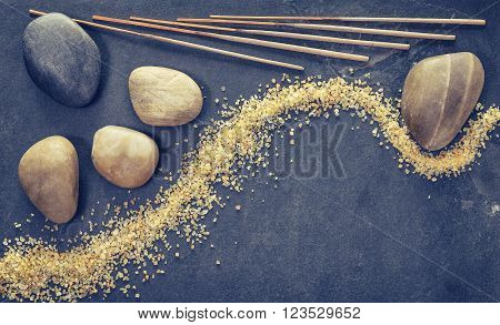 Vintage Filtered Stones On Slate Background With Incense Sticks And Bath Salts.