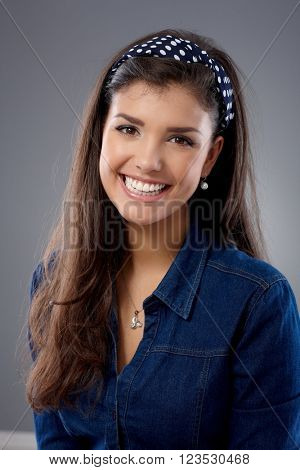 Portrait of beautiful young woman smiling happy, looking at camera.